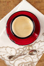 Espresso coffee in red enamel mug silver spoons Royalty Free Stock Photos