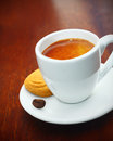 Espresso coffee served with a biscuit Royalty Free Stock Photography