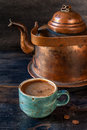Espresso coffee and a vintage coffee pot on wooden background Stock Image