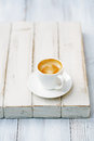 Espresso coffee in white cup on old rustic style table shallow dof Stock Images
