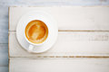 Espresso coffee in white cup on old rustic style table shallow dof Royalty Free Stock Photography