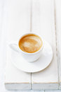 Espresso coffee in white cup on old rustic style table shallow dof Royalty Free Stock Photos