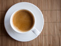 Espresso cup of coffee on bamboo mat Royalty Free Stock Photos