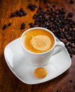 Espresso cup with coffee beans in background Stock Images