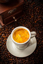 Espresso cup in coffee beans Royalty Free Stock Photo