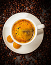 Espresso cup in coffee beans top view Royalty Free Stock Images