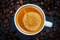 Espresso cup of with coffee beans top view Royalty Free Stock Photos