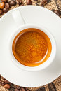 Espresso cup of coffee top view in the background beans Royalty Free Stock Photo