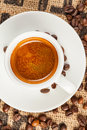 Espresso cup of coffee top view spilled beans Stock Photo