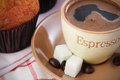Espresso with cupcake cup sugar cubs and coffee beans and a Stock Image