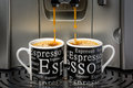 Espresso cups two filled by an automatic machine Stock Photo