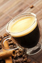 Espresso diagonal with coffee beans and cinnamon Royalty Free Stock Photography