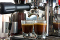 Espresso double shot in coffee maker Stock Photos
