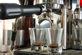 Espresso double shot starting in maker Royalty Free Stock Image