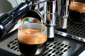 Espresso, extraction from coffee machine Royalty Free Stock Image