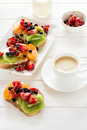 Espresso and fruit dessert sandwiches with ricotta cheese, kiwi, apricot, strawberry, blueberry and red currant Royalty Free Stock Photo