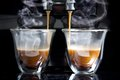 Espresso golden flowing into the cups Stock Photography