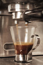 Espresso shot maker pulling a Royalty Free Stock Photography