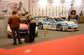 Essen motor show germany december visitors admire tunned cars bmw and porsche during in germany on december Stock Photo
