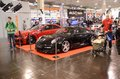Essen motor show germany december visitors admire tunned cars during in germany on december Stock Photo