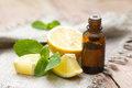 Essential aroma oil with lemon and mint Royalty Free Stock Photos