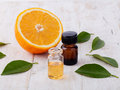 Essential aroma oil with orange. Royalty Free Stock Photo