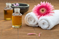 Essential oil, flower on towel, flower float on water fore healt Royalty Free Stock Photo