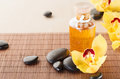 Essential oil, massage stones and orchid flowers Royalty Free Stock Photos