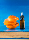 Essential oil with orange slices, bottle and dropper Royalty Free Stock Photo