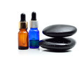 Essential oil with zen stone on white background Stock Image