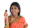 Estate agent happy traditional indian business woman or realtor showing keys isolated over white background Stock Photo