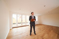 Estate agent looking around vacant new property looks Royalty Free Stock Photography