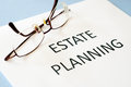 Estate planning on blue background Stock Photos