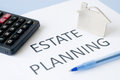 Estate planning on blue background Royalty Free Stock Image