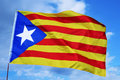 Estelada the catalan separatist flag an waving over blue sky Stock Photos
