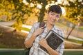 Estudante fêmea feliz looking away de raça misturada Imagens de Stock