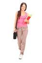 Estudante fêmea com passeio do saco e dos livros Foto de Stock Royalty Free