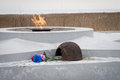 The eternal flame, in memory of the victims of 1941-1945, a bullet Pierced the helmet.