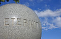 Eternity engraved around granite ball in a circle never ending Royalty Free Stock Photos