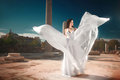 Ethereal, divine bride with flying, shiny dress standing in temp Royalty Free Stock Photo