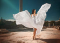 Ethereal divine bride with flying shiny dress standing in temp temple ruins ancient mosaic and floor Royalty Free Stock Image