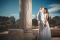 Ethereal, divine bride with shiny dress and groom standing near Royalty Free Stock Photo