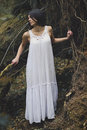 Ethereal young woman in dark forest Royalty Free Stock Photo