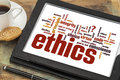 Ethics word cloud on digital tablet of words or tags related to and moral dilemma a Stock Images