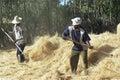 Ethiopian farmer and servant threshing grain harvest Royalty Free Stock Photo