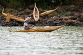 Ethiopian man transports goods in a papyrus boat. Royalty Free Stock Photo