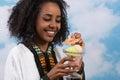 Ethiopian woman with icecream Stock Photo