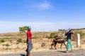Ethiopian woman walking on the road.