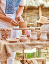 Ethnic art skilled master creating pot of clay young ceramic people outdoors ancient historic craft process tableware Royalty Free Stock Photos