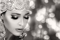Ethnic beauty fashion ethnic woman monochrome portrait closeup hindu face with traditional clothes jewelry and makeup with copy Royalty Free Stock Photo